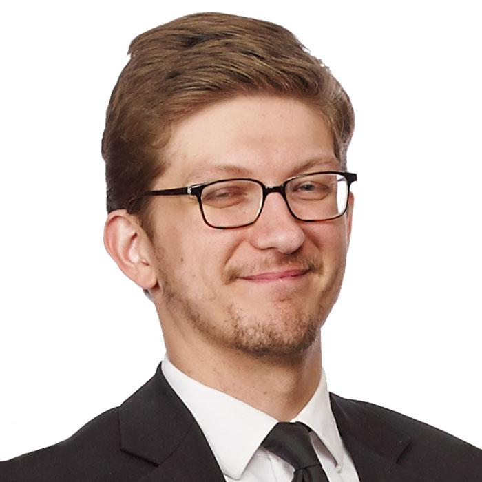 Travis Hendra : Associate Librarian